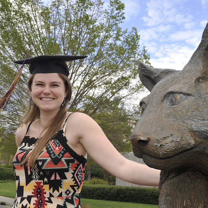 Marisa Beatty, a graduating student from Chapel Hill, joined in a campus tradition recently as she had her photo taken with the Catamount statue. Beatty and her classmates in WCU's spring class will be participating in commencement ceremonies Friday, May 6, and Saturday, May 7.
